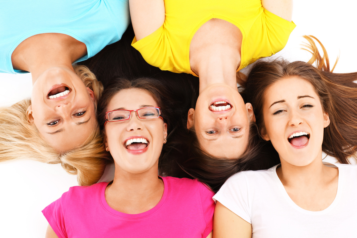 A picture of a joyful group of friends lying over white background