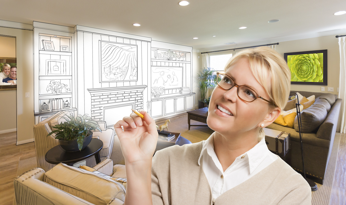 Creative Woman with Pencil Over Custom Living Room and Design Drawing.
